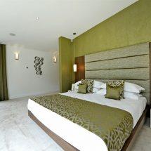 Как оформить спальню в зеленом цвете